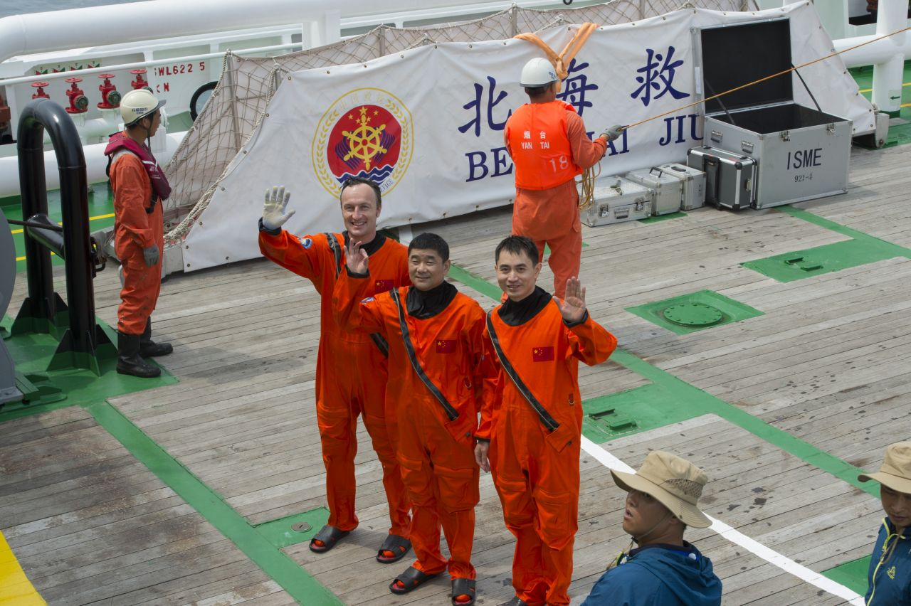 ESA astronaut Matthias Maurer joined Chinese colleagues Liu Boming and Ye Guangfu in Yantai, China to take part in their sea survival training, on 19 August 2017.