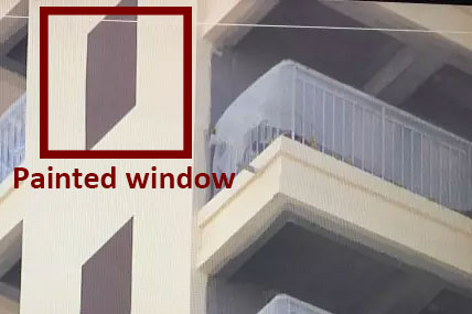 Fake windows painted on Chinese apartment building