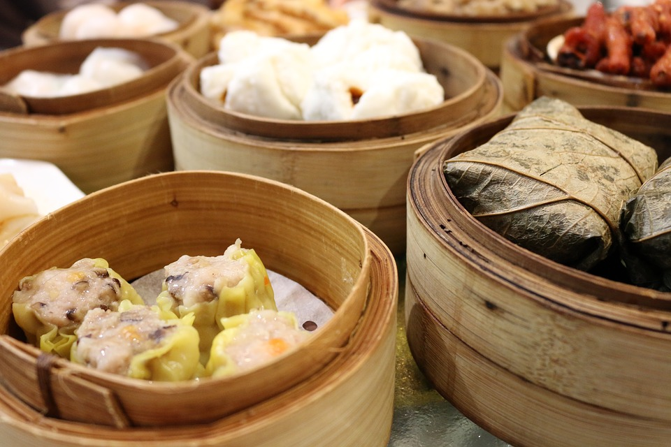 chinese dumplings in baskets shao mai in foreground