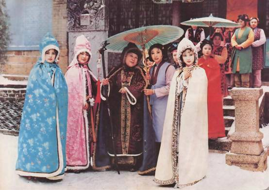 actors wearing chinese qing dynasty costumes on set of 1987 tv drama dream of red chamber beijing china