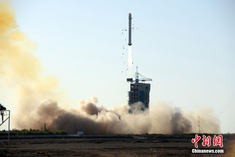 A Long March 2D clears the tower at Jiuquan, launching the Chuangxin-1-04 satellite in September 2014.