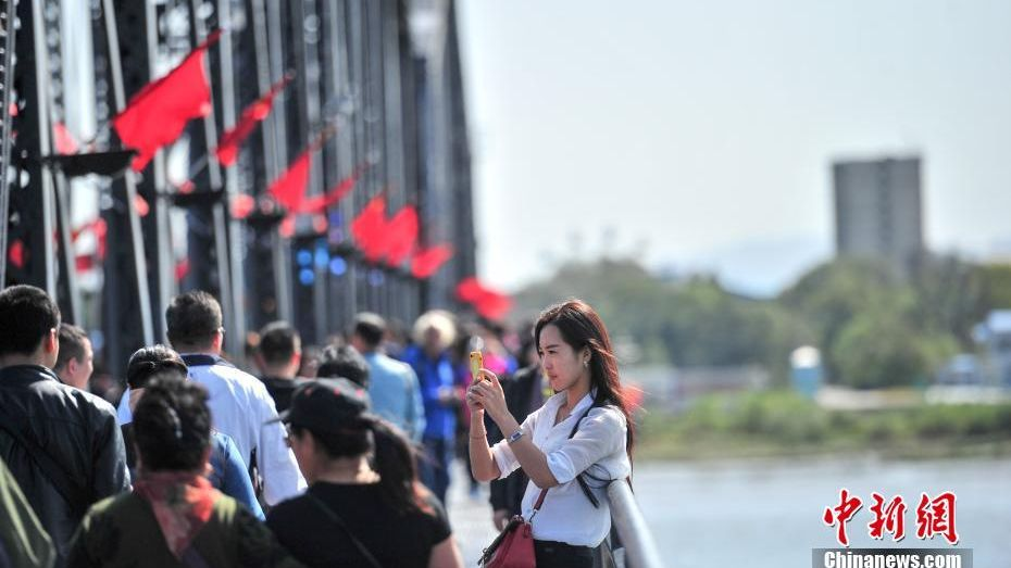 Chinese tourists visit the border city of Dandong to enjoy North Korea views..