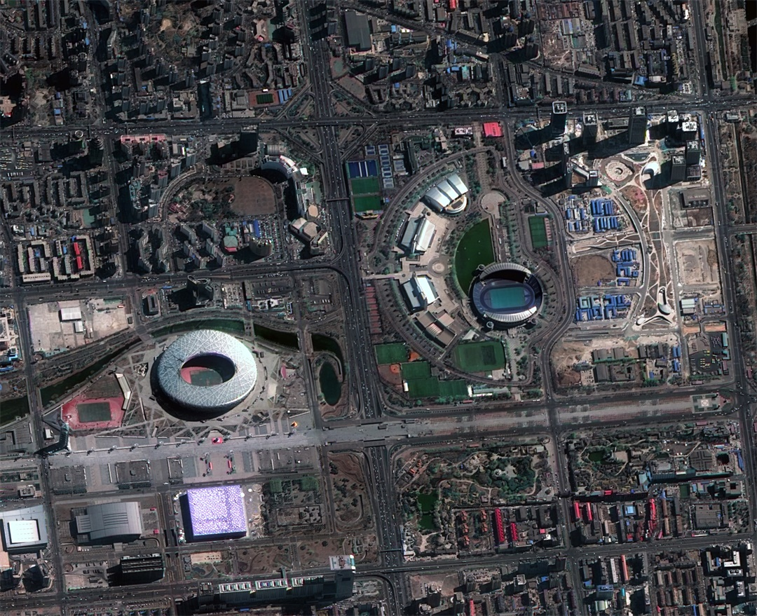 An image of Beijing showing the Bird's Nest stadium, Water Cube and Olympic Park.