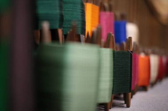 close up of spools of silk thread in different colours