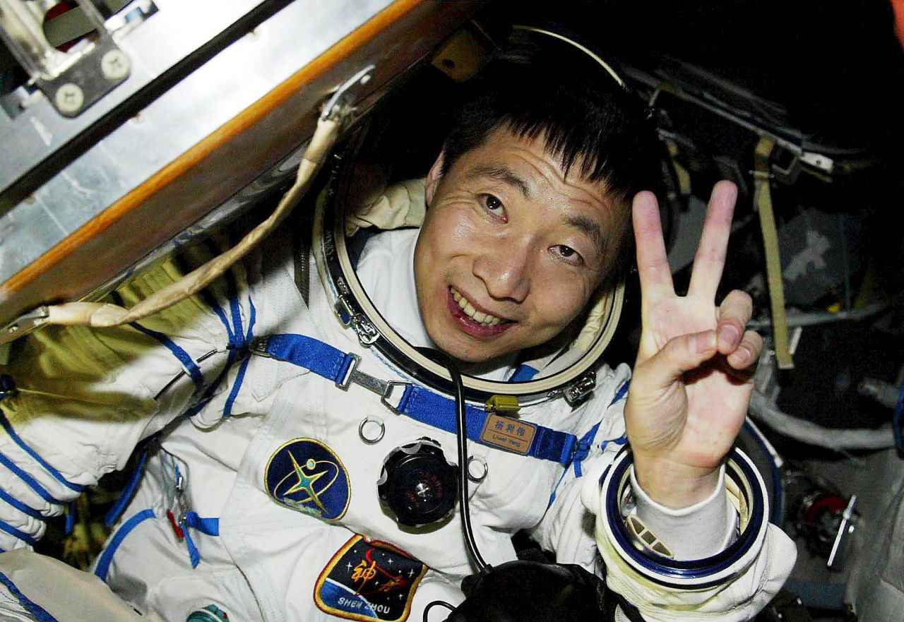 Yang Liwei, who became China's first astronaut in space, emerges from his Shenzhou reentry capsule in October 2003.