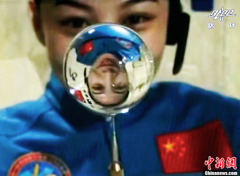 Chinese astronaut Wang Yaping during a live science lecture to school classrooms from orbit aboard Tiangong-1 in July 2013.