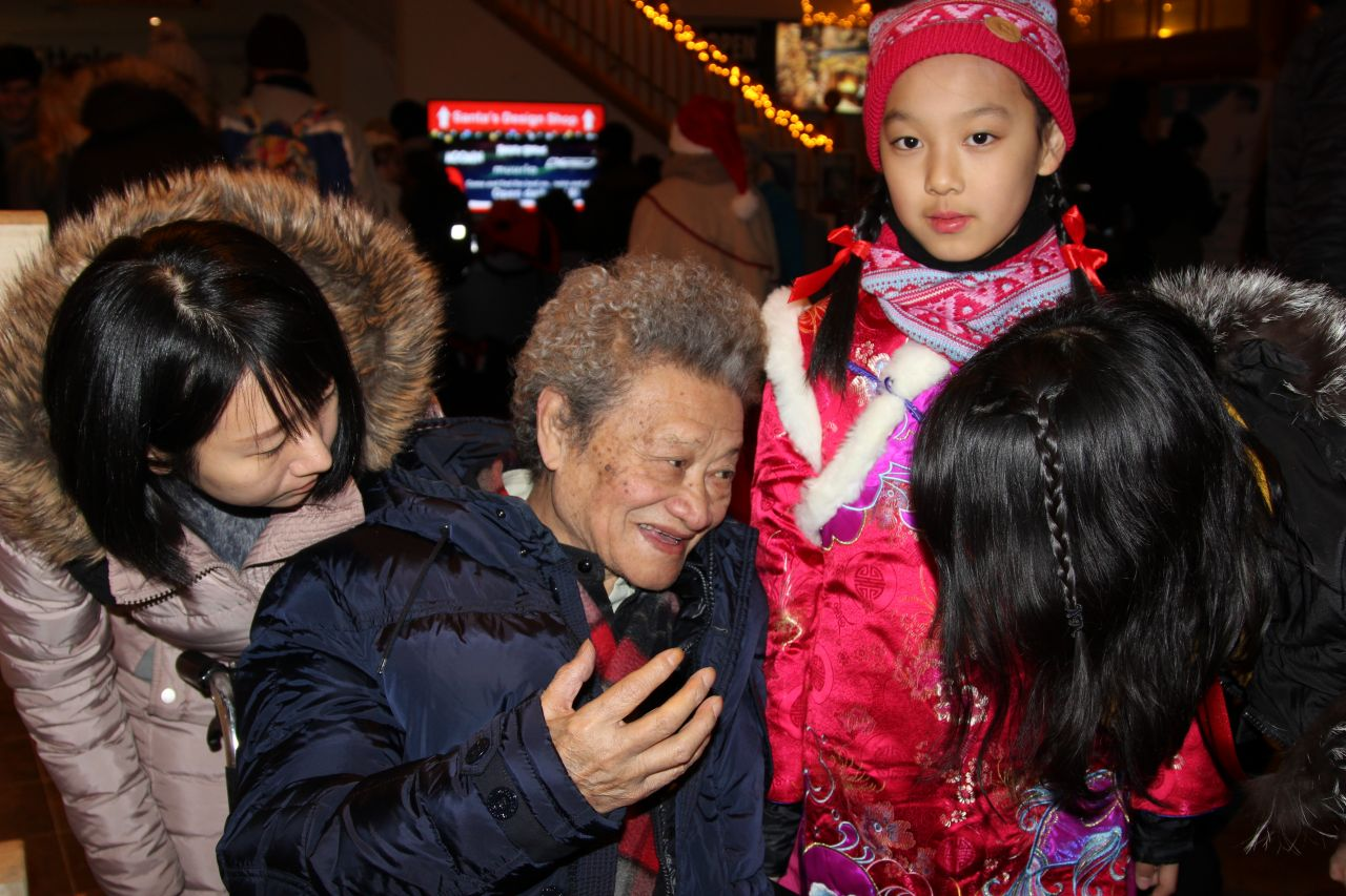 """When I'm around kids I become young again,"" said 85-year-old conductor Yang Hongnian, pictured here alongside 10-year-old choir member Xu Yifan."