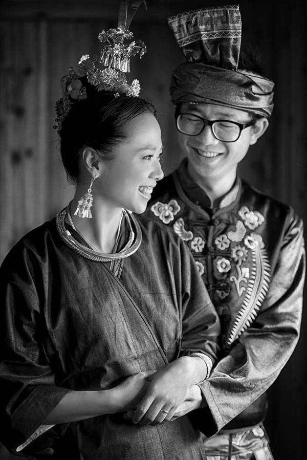 black and white portrait of Yang Lidan and her husband in traditional wedding clothes