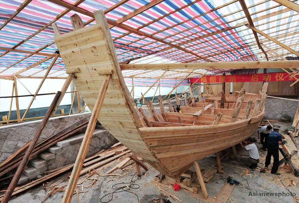 A Fujian Boat Building Workshop With Large Half Built Wooden Inside