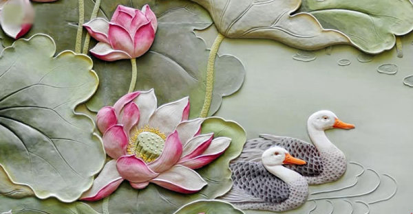 Close-up of an ousu oil-clay relief artwork with lily pads and ducks.