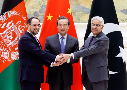 The foreign ministers of China, Afghanistan and Pakistan met in Beijing on December 26, 2017.