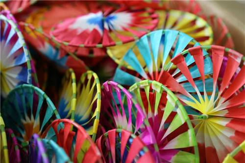 A close-up photo of brightly-coloured Beijing Chinese New Year pinwheels.