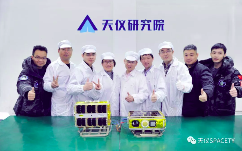 The SPACETY team with the Xiaoxiang-2 and Quantutong-1 CubeSats.