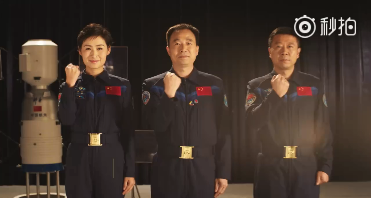 The crew of Shenzhou-9 in the Astronaut Centre of China training video.