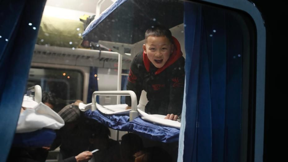 A child can barely conceal his delight at the prospect of an overnight journey on the train.