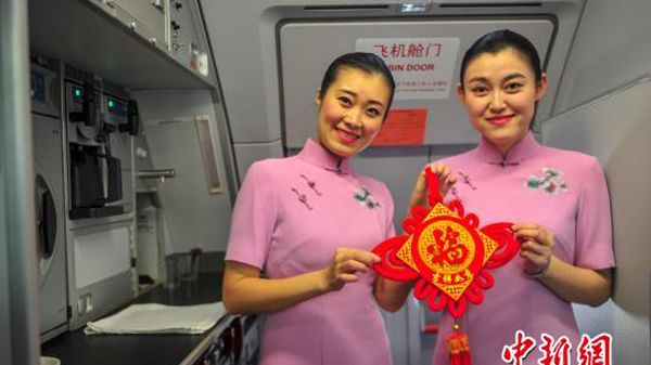 China Southern Airlines flight attendants dressed in traditional cheongsam dresses and decorated the plane's cabin to welcome the coming Spring Festival.