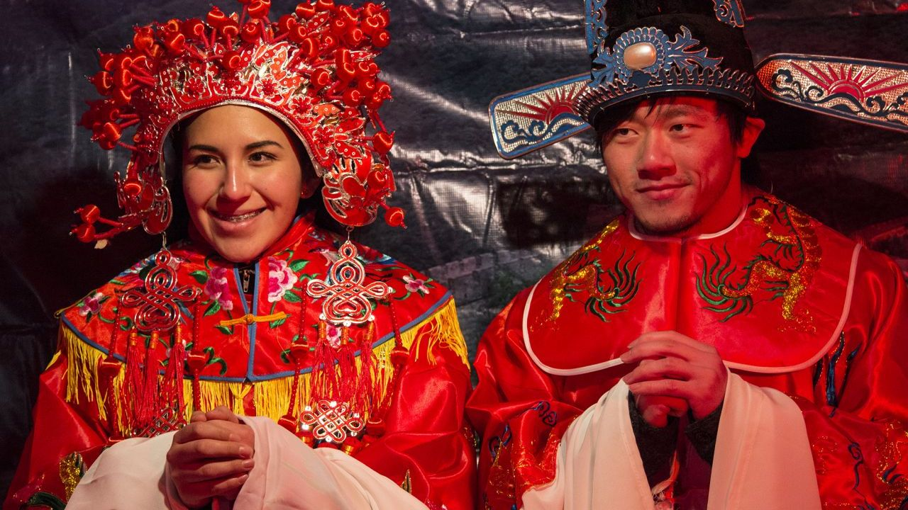 People trying on Chinese costumes in Helsinki.