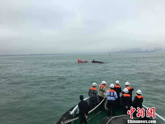 rescuers investigation hainan freighter ship passenger ferry collision guangdong hainan south china