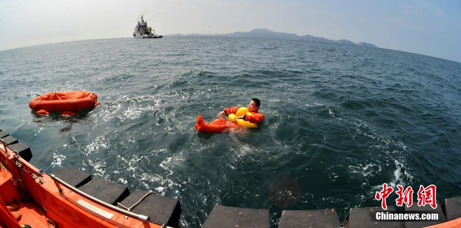 Yang Liwei participating in sea survival training at Yantai, Shandong Province, which also included ESA astronauts, in August 2017.