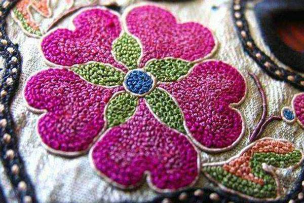 china shaanxi embroidery textured pink flower closeup