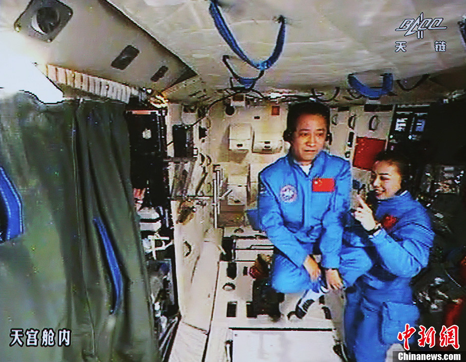 Astronauts Nie Haisheng and Wang Yaping (right) demonstrate meditation in microgravity to school students back on Earth during the Shenzhou-10 to Tiangong-1 in June 2013.