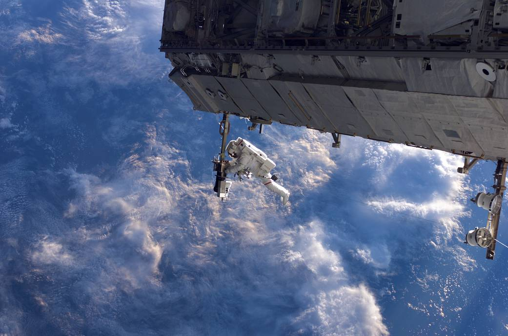 NASA astronaut Robert Curbeam works on the International Space Station's S1 truss during the space shuttle Discovery's STS-116 mission in December 2006.