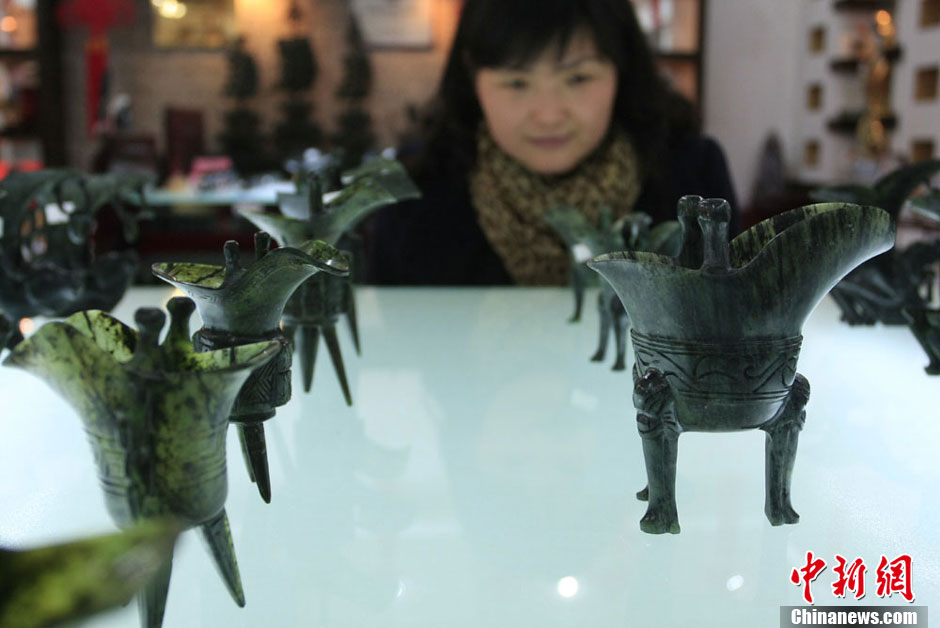 person looking chinese jade cup vessels exhibition