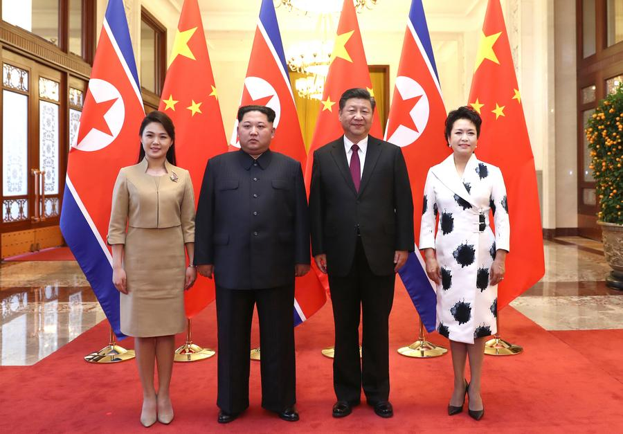 Chinese president Xi Jinping (2nd R) and his wife Peng Liyuan (1st R) meet with Kim Jong Un (2nd L), chairman of the Workers' Party of Korea and chairman of the State Affairs Commission of the Democratic People's Republic of Korea, and his wife Ri Sol Ju