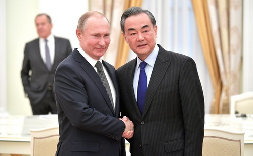 Visiting Chinese Foreign Minister Wang Yi meets with Russian President Vladimir Putin in Moscow on Thursday April 5.