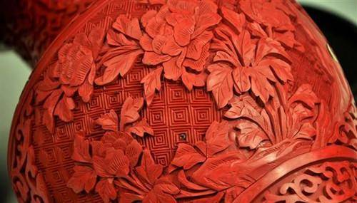 chinese carved red lacquer pattern design flowers concentric squares closeup