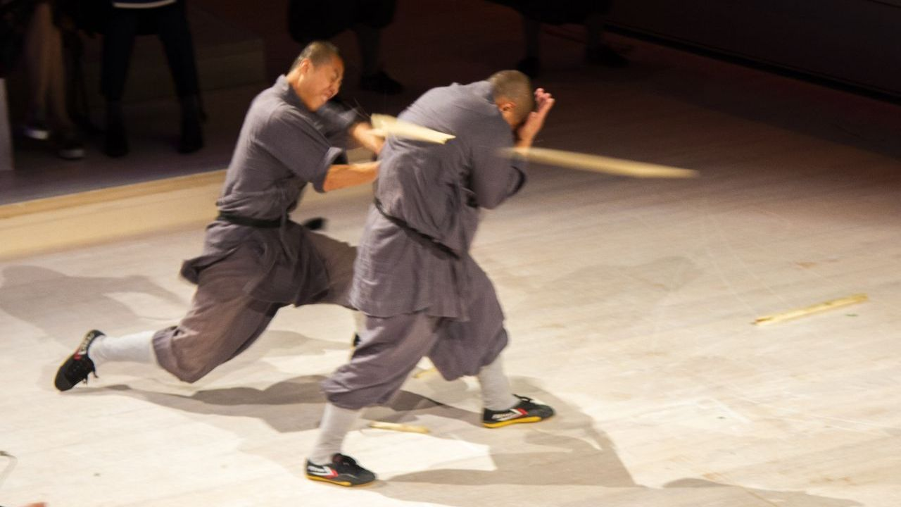 Performers from the Martial Monk Performance Group of The Shaolin Temple breaking sticks.