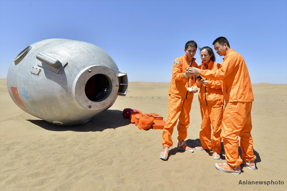 Astronauts Ye Guangfu (left), Wang Yaping (centre) and Chen Dong outside a Shenzhou training capsule in the Badain Jaran desert on May 11, 2018.