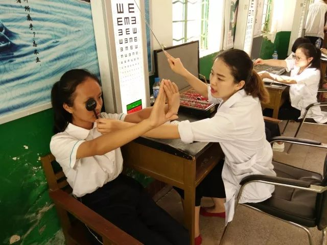 A girl taking a vision test in a school in the southern province of Yunnan.