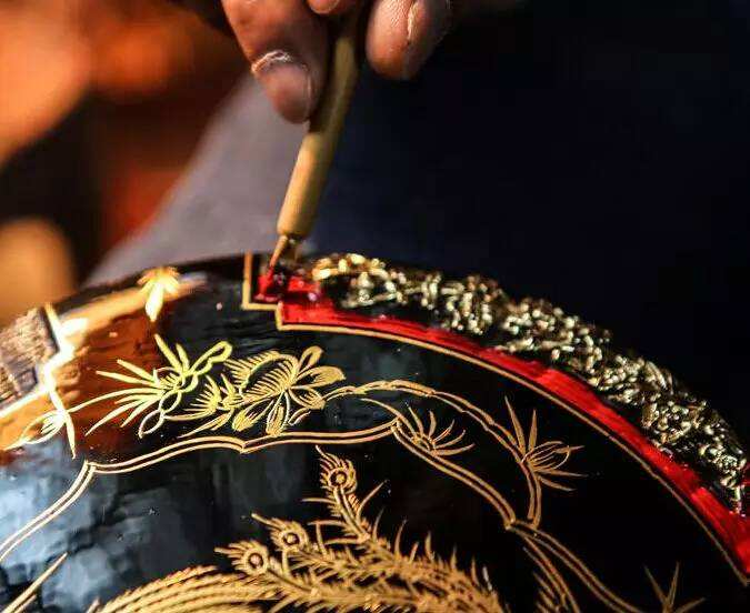 china fujian lacquer basket decoration black background gold decoration red lacquer paint craftsperson hands closeup