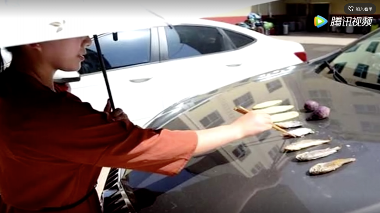 Chinese woman roasts fish on car bonnet during hot weather | gbtimes com