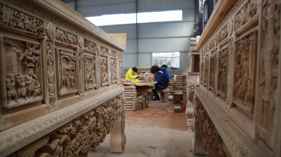 china jiangxi province leping opera theatre wood carving people working
