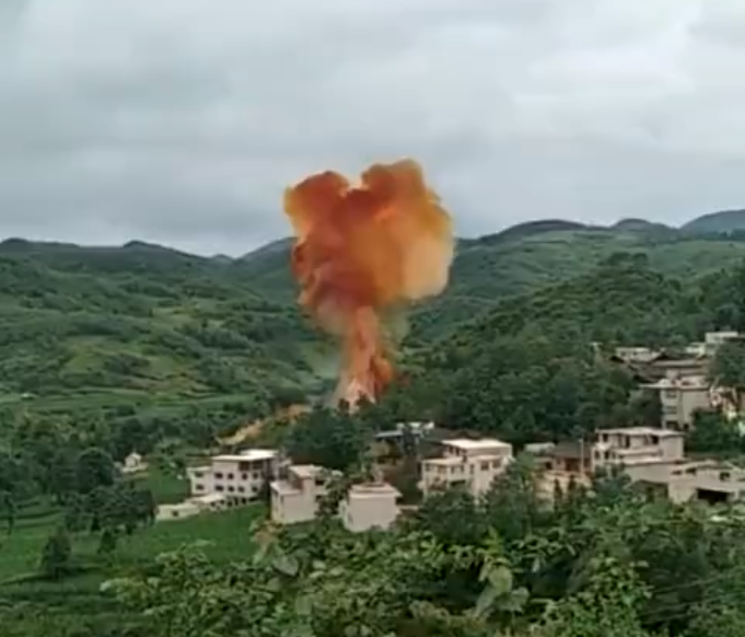 Smoke rises after the spent first stage of a Long March 2C rocket impacts a town in China's Guizhou Province on June 27, 2018.