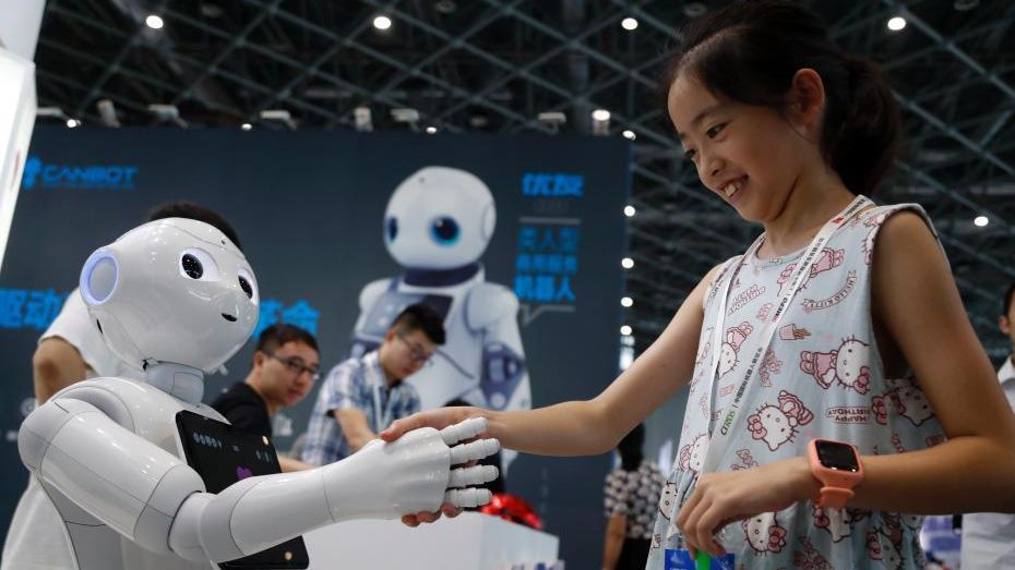 A robot shaking hands with a girl at the 2018 China International Robot Show in Shanghai on Wednesday.