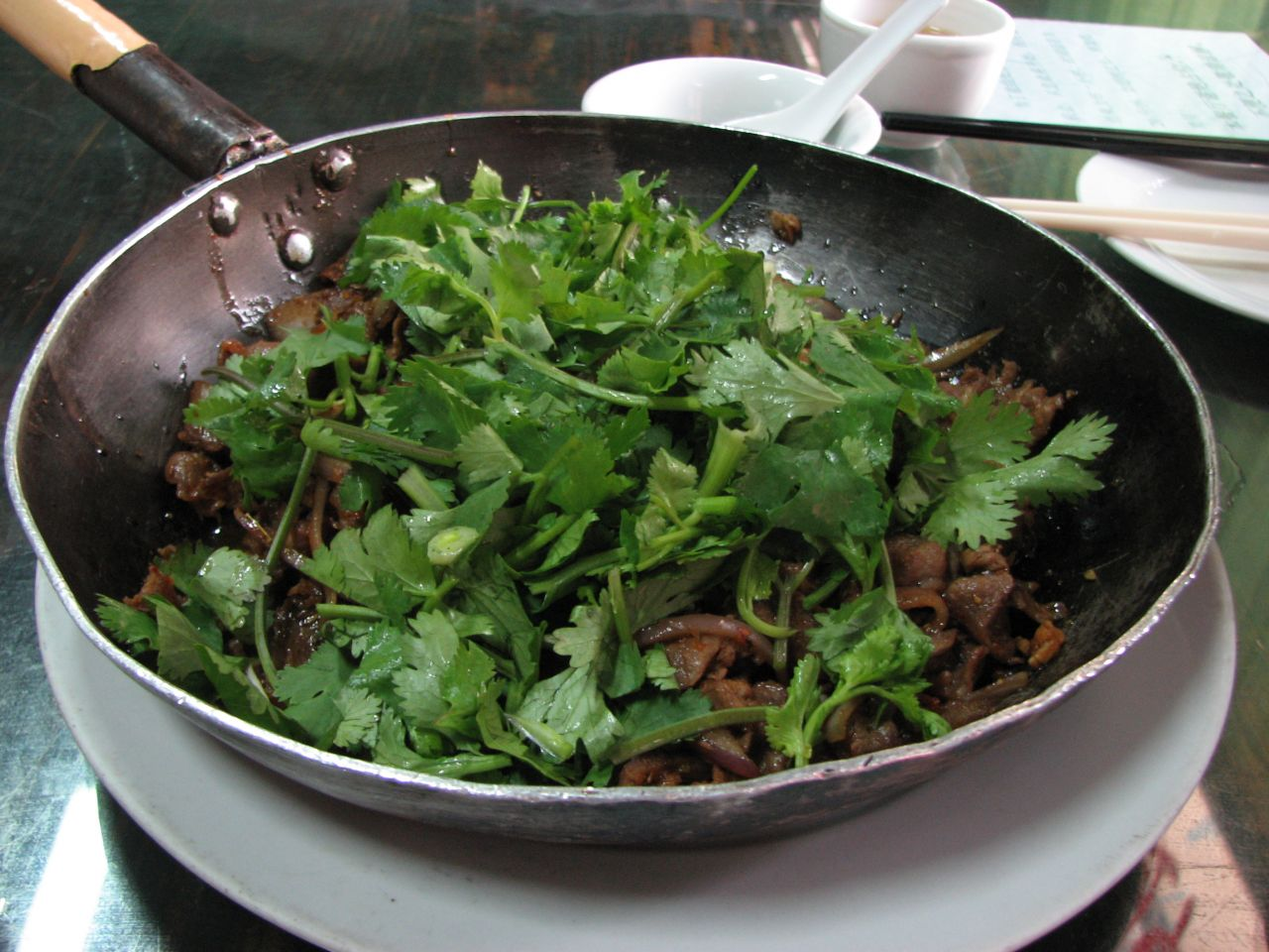 Chinese parsley added to a stir-fried mutton dish.