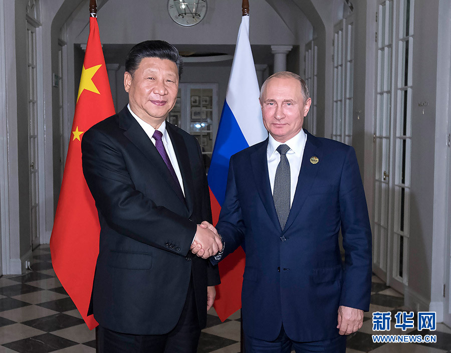 Putin says Russia ready to strengthen ties with China