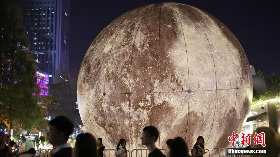 A moon installation set up on the streets of Nanjing, in eastern China's Jiangsu Province, to mark this year's Mid-Autumn Festival.