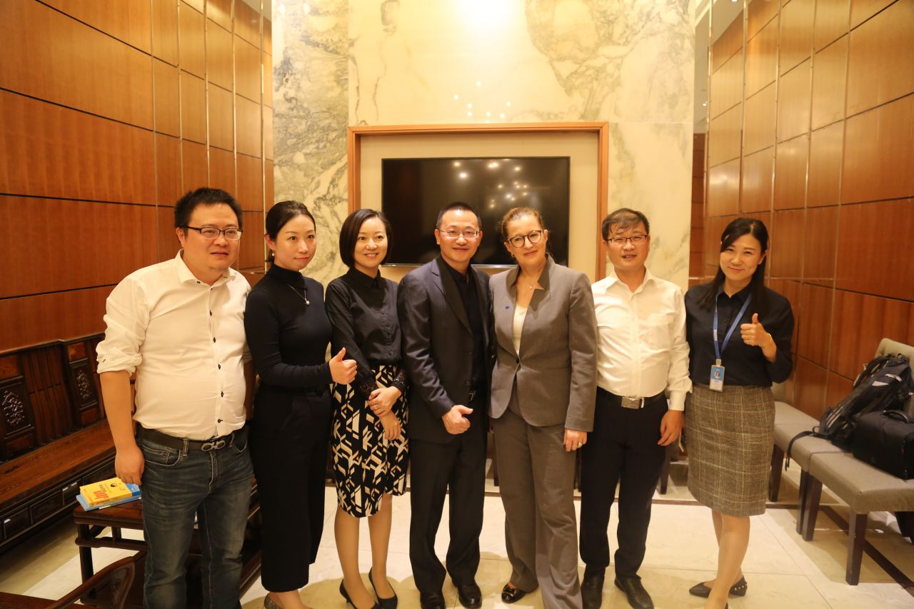 Pia Pakarinen (third right) at a dinner function hosted by Xiaoma, a Hangzhou-based coding company, during a working visit to east China in October.