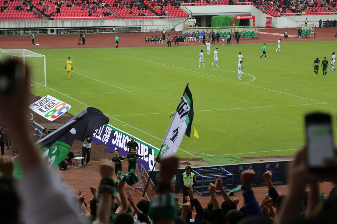 Dong Yu celebrates putting Zhejiang Greentown a goal up.