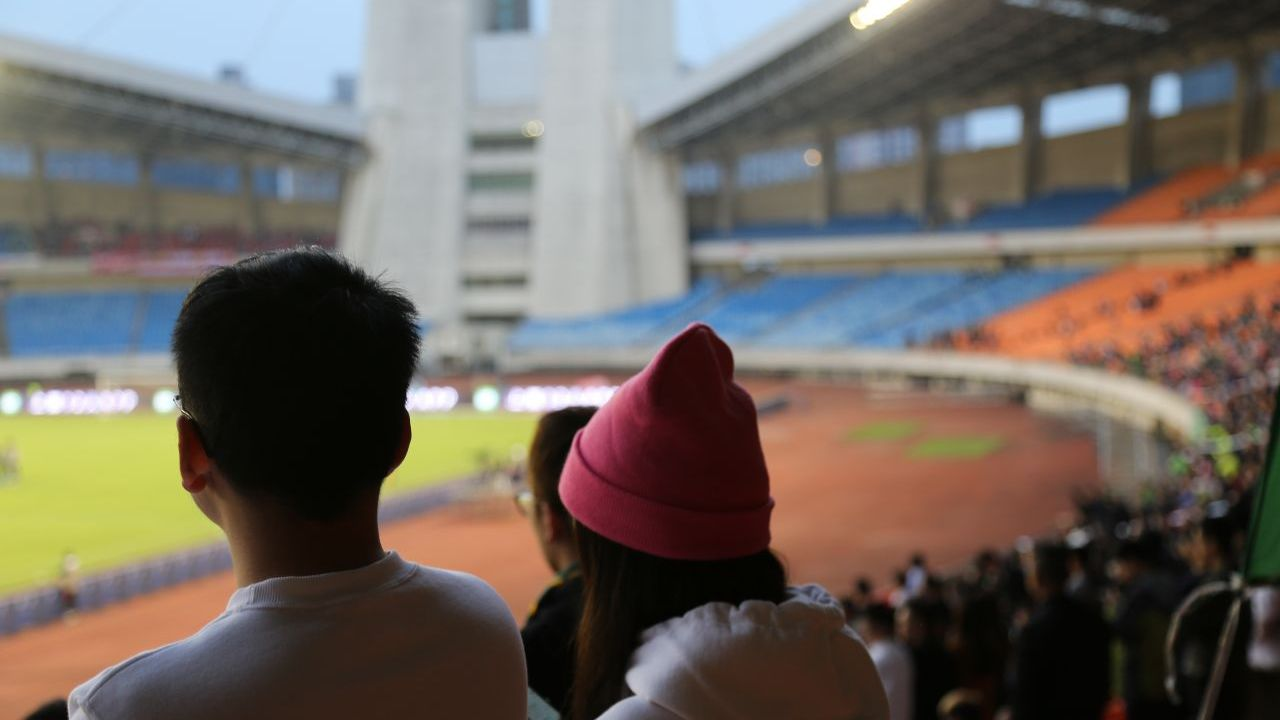 A young couple watch the match unfold.