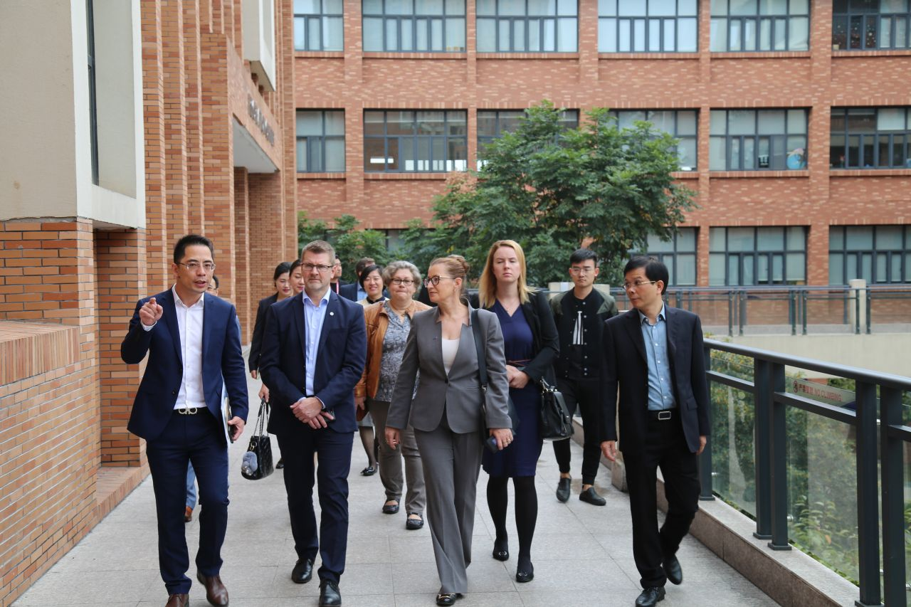 Pakarinen (third from left) is shown around the Hailiang Education campus in Zhejiang Province.