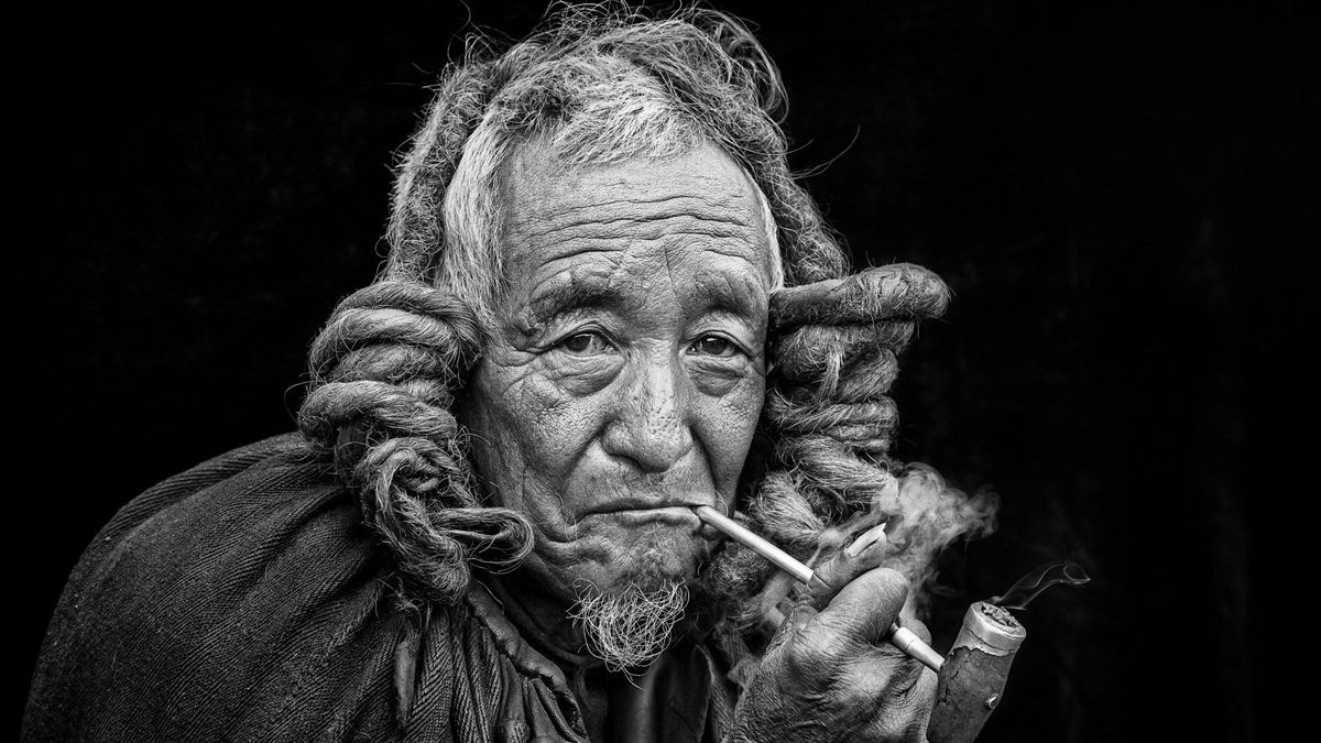 "Chinese photographer Xia Xuejun won third prize in the Fascinating faces and characters category at the 2018 Siena International Photo Awards for the photo ""Yi Ethnic Elder"". The photo was taken in Meigu Village in southwest China's Sichuan Province."