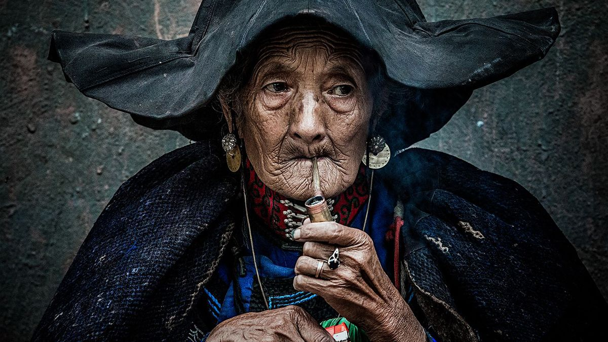 "Chinese photographer Chen Qiang received a remarkable award in the Fascinating faces and characters category at the 2018 Siena International Photo Awards for the photo ""A Smoking Old Woman""."