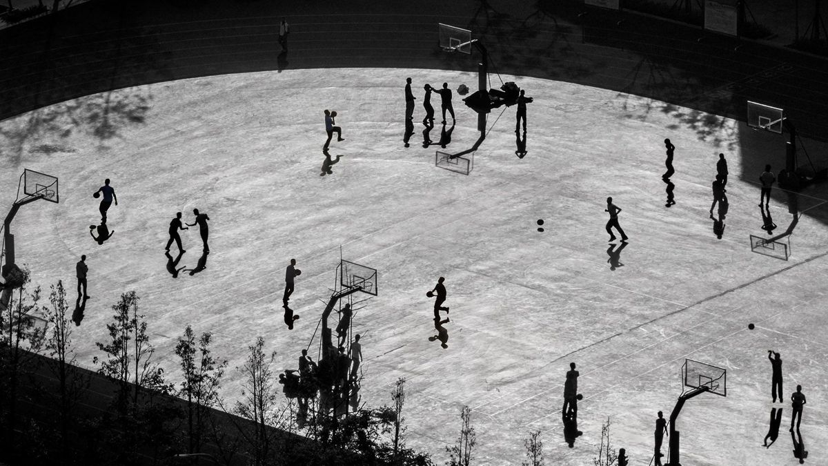 "Chinese photographer Duan Xuezhong received a remarkable award in the General Monochrome category at the 2018 Siena International Photo Awards for the photo ""Basketball Court-2""."