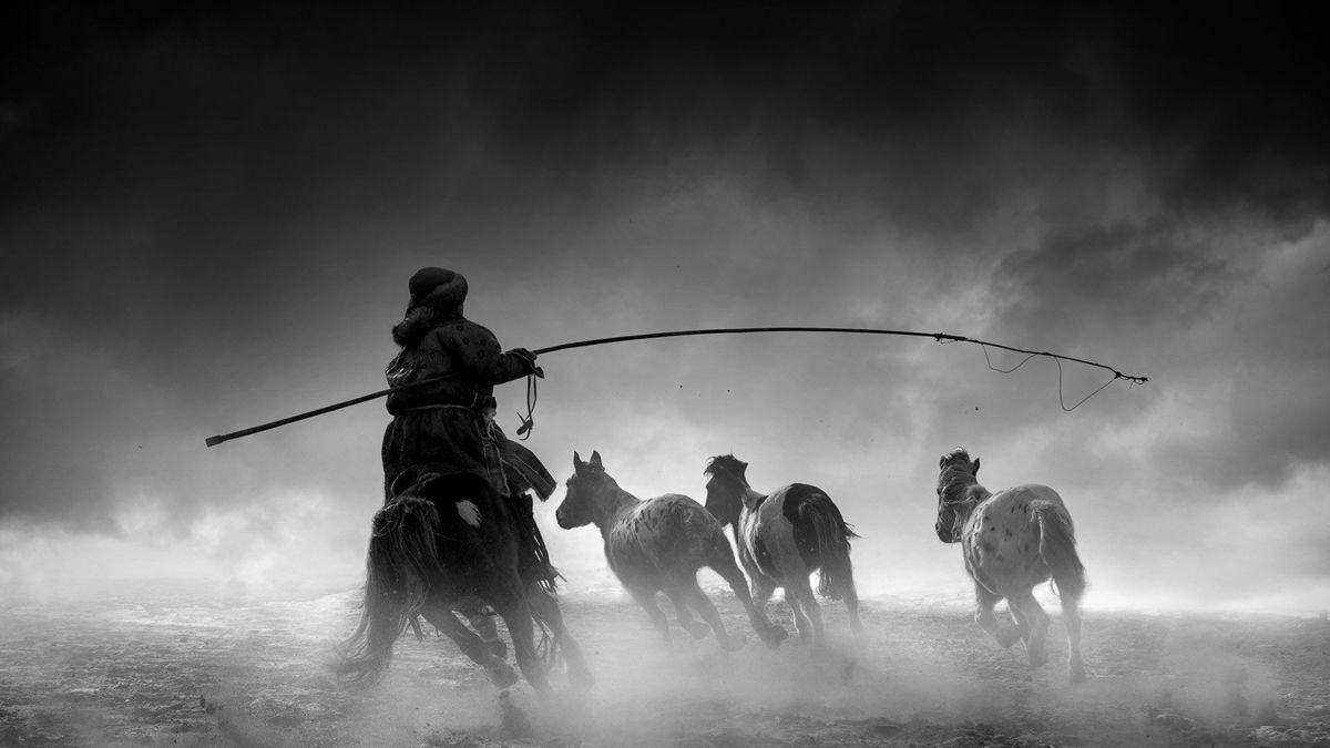 "Chinese photographer Dong Xiaolian received a remarkable award in the General Monochrome category at the 2018 Siena International Photo Awards for the photo ""The Herdsman""."