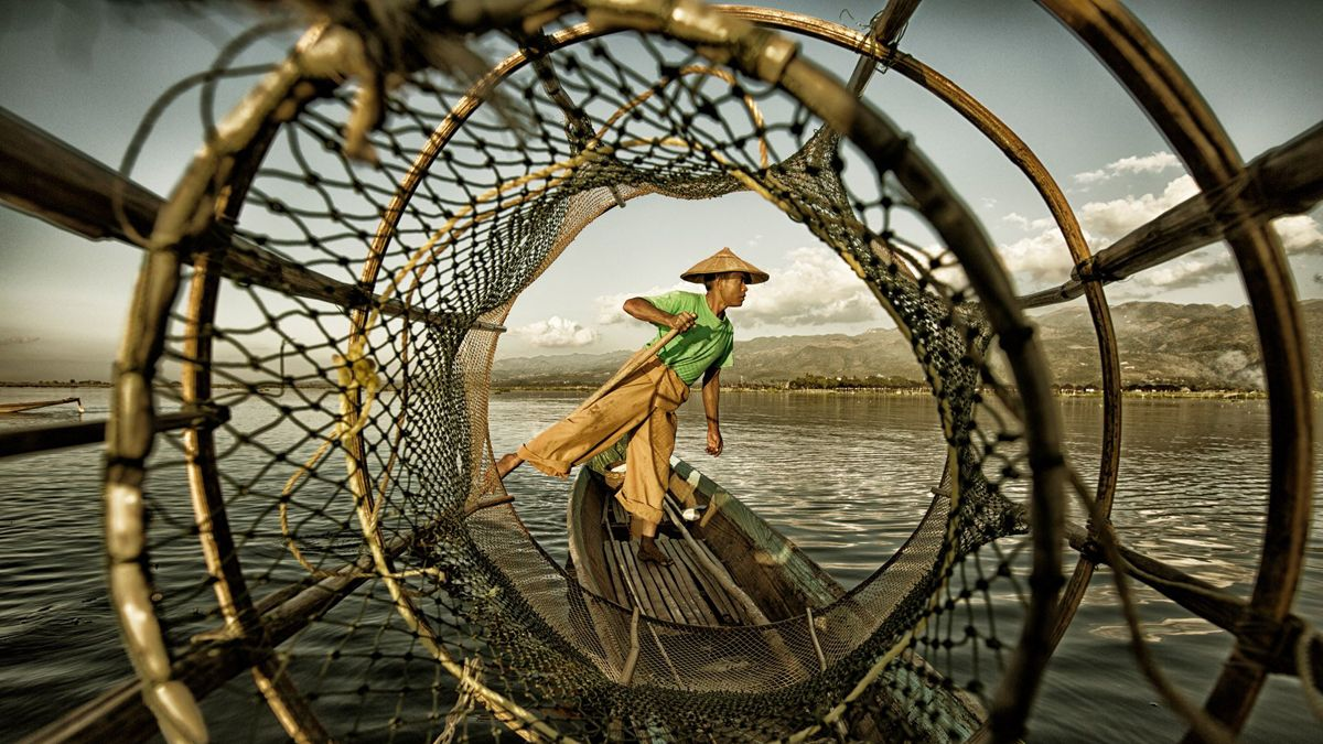 "Chinese photographer Pan Yinzhi's ""Fisherman at Inle Lake"" won the Under 20 prize at the 2018 Siena International Photo Awards. The picture was captured at Inle Lake on the Shan Plateau in Myanmar."